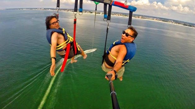 Parasailing above the Tampa Bay Beach with Gators Parasail-selfie stick