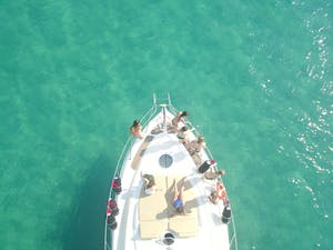 aerial view of girls enjoying on a yacht