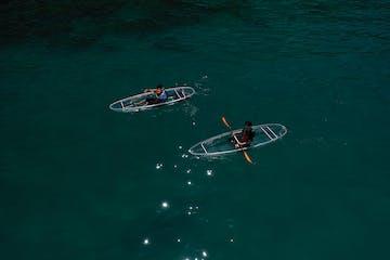 clear kayaks on lake