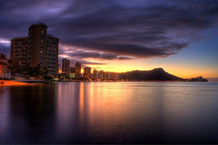 sunrise over the mountains and city with ocean