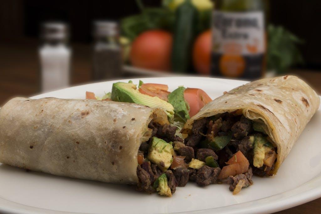 A burrito with avocado