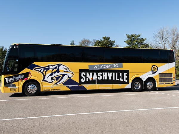 Tour Bus for Gray Line Tennessee with Welcome to Smashville image on side