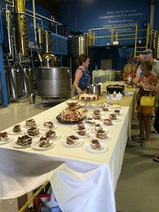 A dessert and drink table at Drum Circle Distillery