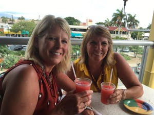Two women enjoying cocktails on food tour in Sarasota, FL