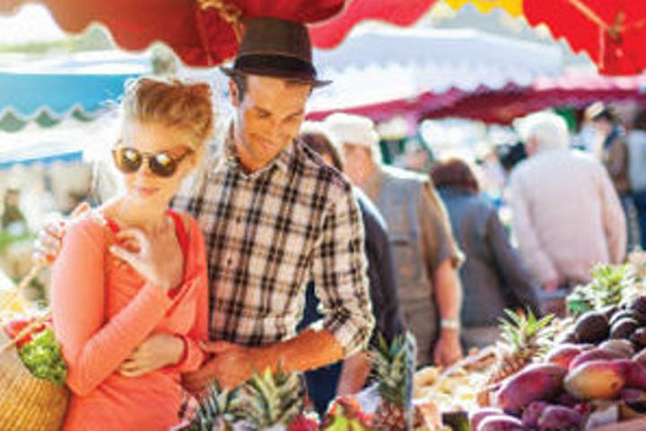 A young couple looking at food stalls at marketplace in Sarasota, FL