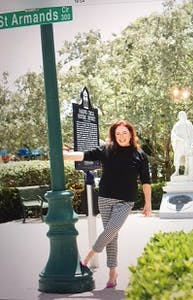Susan Robinson posing near street sign in Sarasota, FL