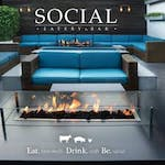 Couches and charcoal fire at Social Eatery and Bar in Sarasota, FL