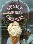 Ice cream cone photographed in front of the exterior window of Venice Creamery in FloridaVenice Creamery