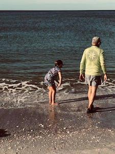 Tourists walking along the beach in Sarasota, FL