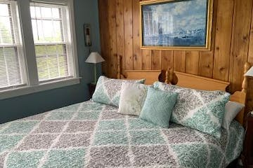 a room with a green blanket