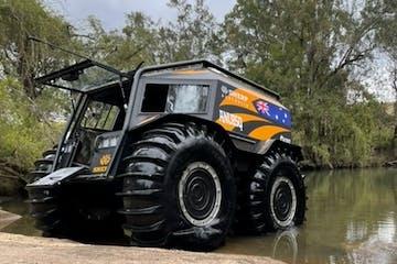 a truck driving down a dirt road