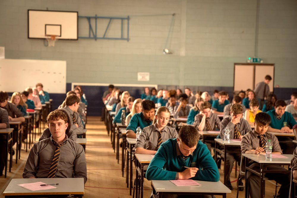 a group of people sitting an exam in Ireland.