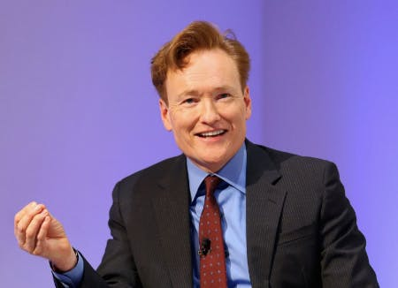 Conan O'Brien wearing a suit and tie