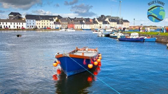 a small boat in a harbor next Galway City