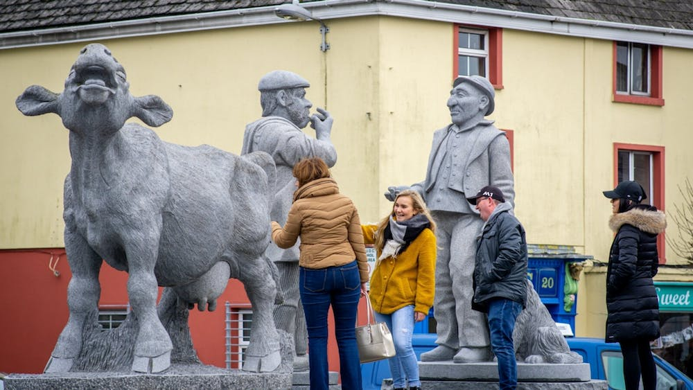 A group of people doing a walking tour of Ennis