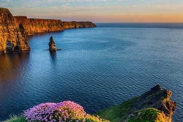 a body of water and the cliffs of moher
