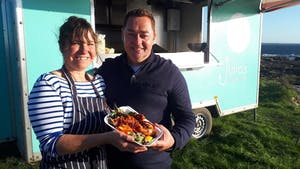 Neven Maguire standing in front of a plate of food