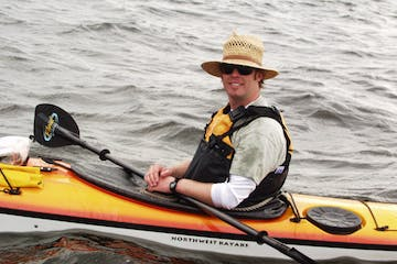 Man smiling in a kayak