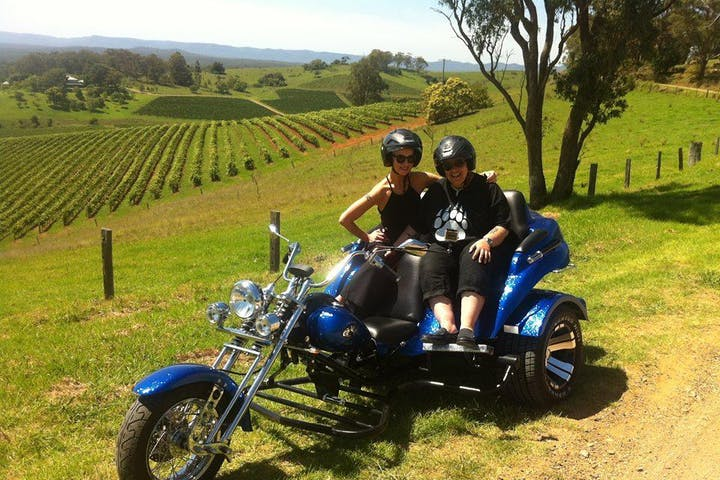 Couple riding a blue motorbike