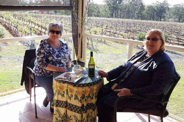 2 girls having a picnic in a winery farm