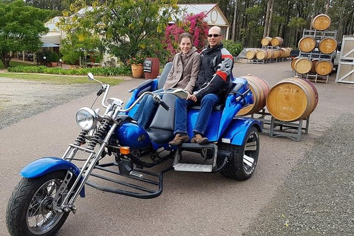 2 people on a blue motorbike