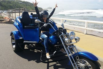 a person sitting on a blue motorcycle