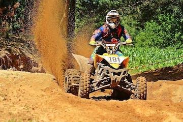 ATV rider kicking up dirt