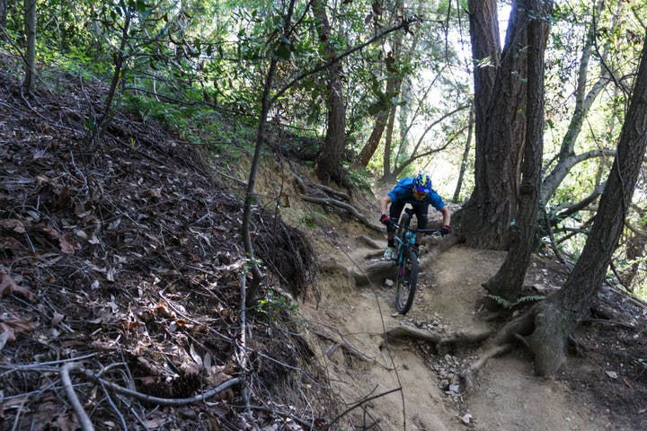 man riding down advanced trail