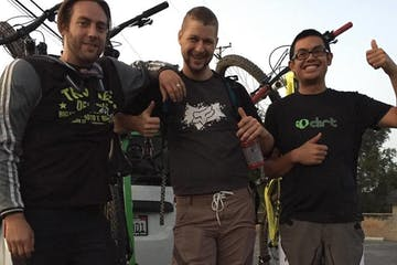 Three mountain bikers smiling for group picture