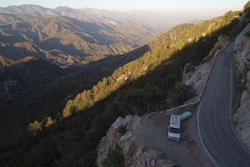 Aerial view of Mt Wilson and shuttle bus parked on winding road