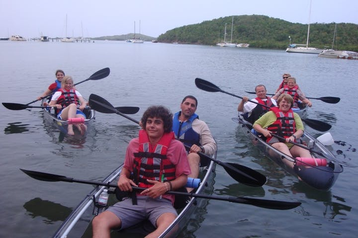 Group picture of kayakers in water
