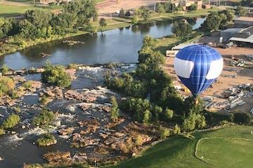 blue balloon in flight