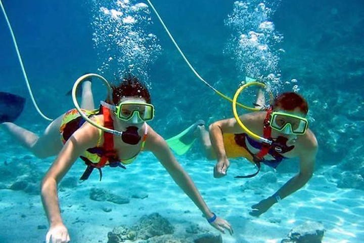 two people snorkeling