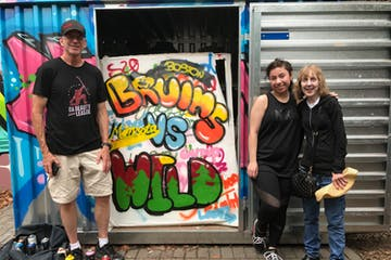 group standing in front of graffiti