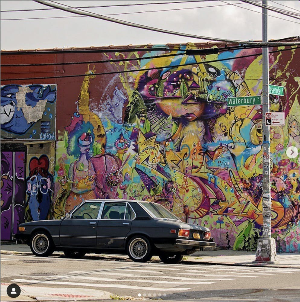 colorful graffiti on the side of a road