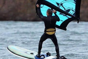 a person riding a surf board on a body of water