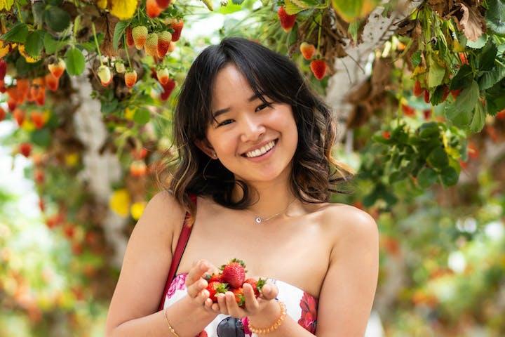woman enjoying a Strawberry Farm