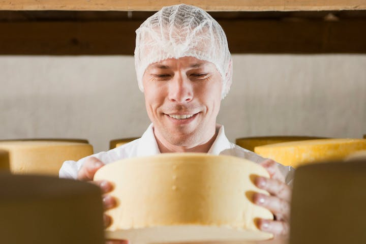 Man making cheese