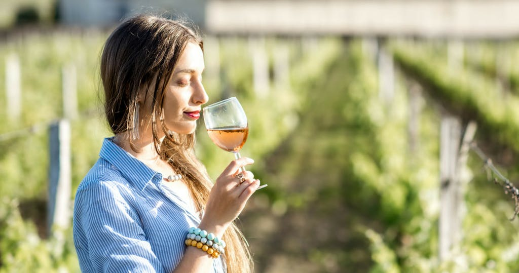 woman tastes wine