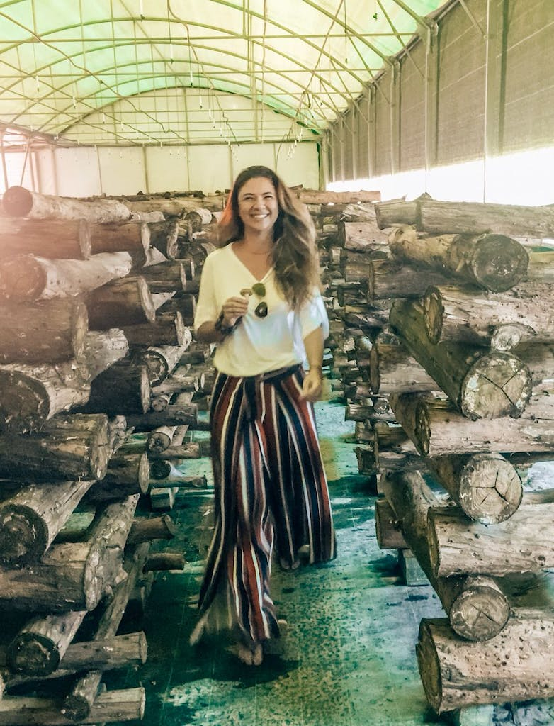 Woman enjoying a tour in a mushroom farm