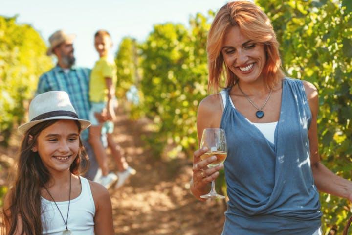 A woman enjoys a grape's tour