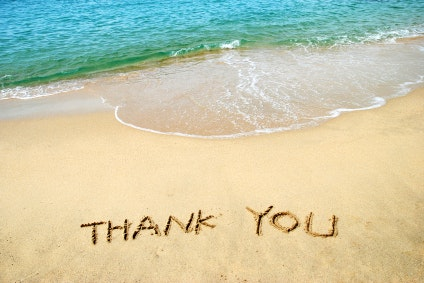 Thank You written on beach