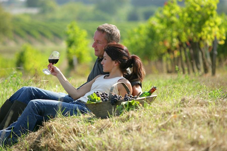 Couple Wine Tasting in Vineyard