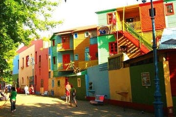 a group of people standing in front of La Boca