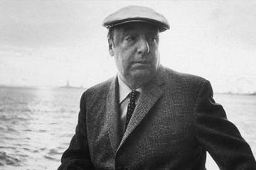 Pablo Neruda wearing a suit and hat