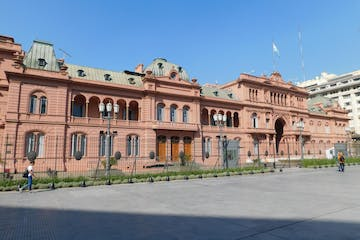 a large brick building with Casa Rosada in the background
