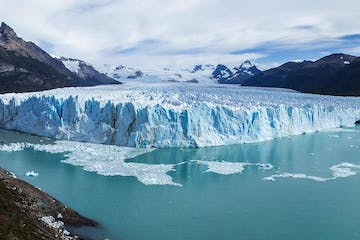 a group of ice water and Perito Moreno Glacier in the background