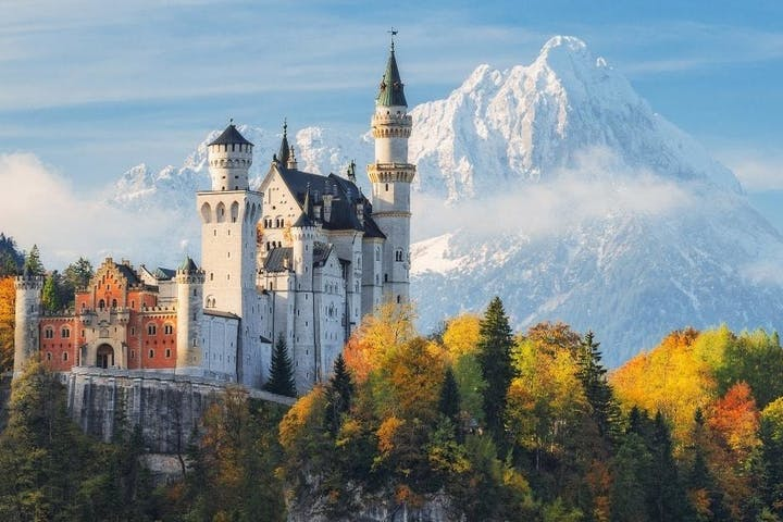 Neuschwanstein Castle and the snow-capped mountains behind