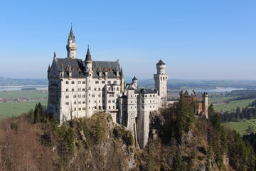 View of Neuschwanstein Castle in summer, sun is shining