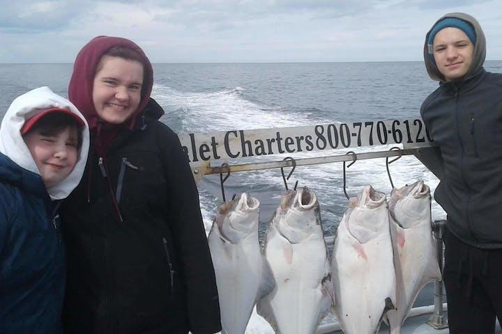 People next to halibut
